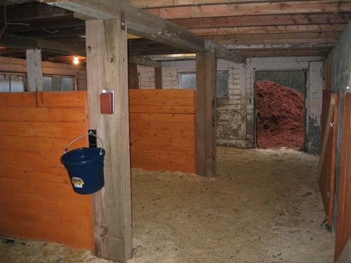 This is the back side of the barn. I designed it in such a way that my horses could use it as a run in or be separated in their own stalls if need be.